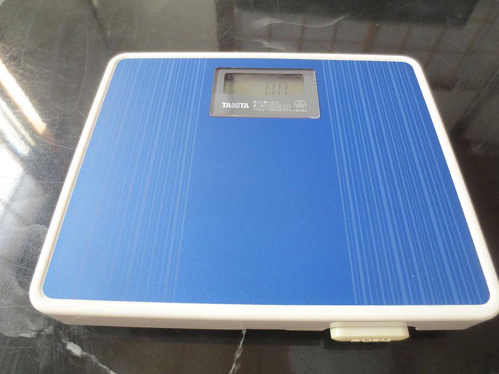 人間の体重を測る機械。